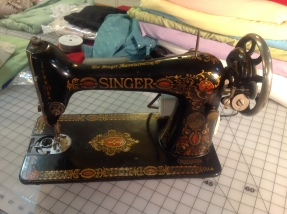 1911 Singer, converted to an electronic model by the original owner. It was found in the dusty corner of a thrift store for $65. I have since found the parts to convert it back to it's original hand crank format. Now all it needs is a bed and a cleaning!