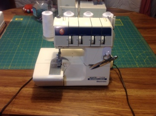 White Superlock 734 DW Serger. Purchased for $150 with the advice that parts couldn't be found once they wore out. Not so! In the age of the Internet, finding blades and parts has not been a problem at all... this ended up being a fantastic purchase. I use it with each project.