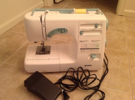 Kenmore model # 385-16231, Found at a neighborhood thrift for $29.99. Apparently this version of the Kenmore Machine was produced by Janome. This lovely machine has a wonderfully quiet and smooth motor. The stitches are refined and steady. Bonus features are a treat: needle up/down, speed control, needle threader, automatic buttonholes, etc.) The cornflower-blue accents on the machine are a nice touch too.