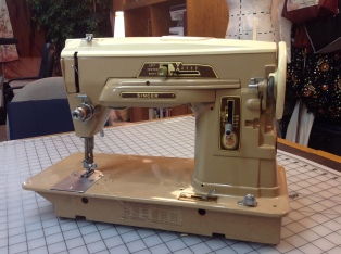 "1950's Singer 403. This Vintage machine utilizes ""cam"" or cartridges to form anything other than a straight stitch. Found for $8.00 at Goodwill."