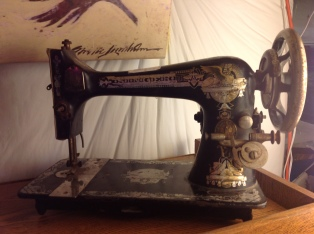 The infamous Singer Model 27 with the Golden Sphynx/Memphis Egyptian decal (treadle version, Spoked handwheel) It is badly worn, and will do well with some cleaning and care.